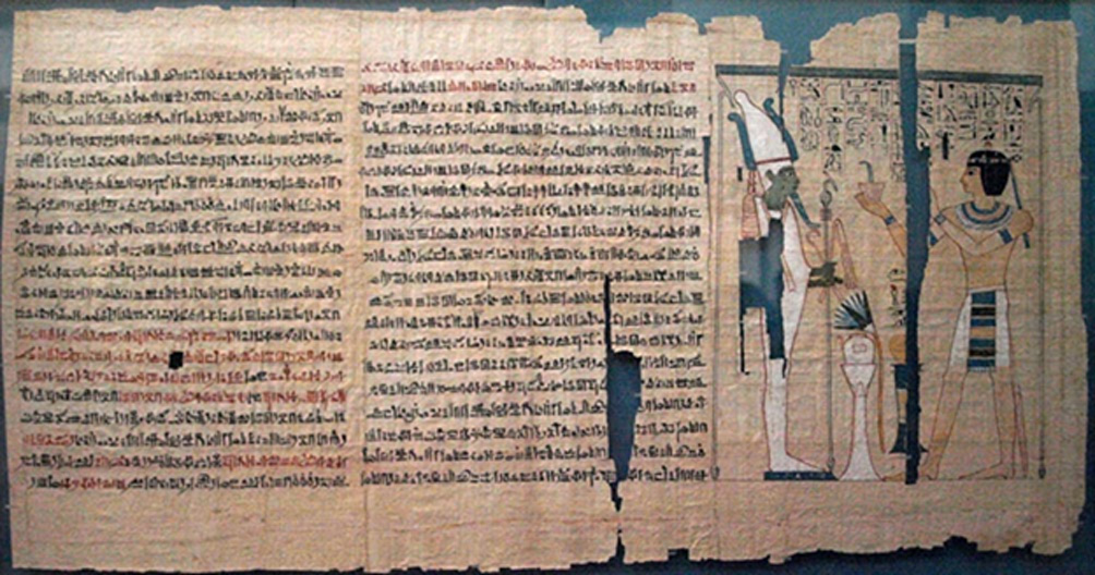 Part of the Book of the Dead of Pinedjem II. The text is hieratic, except for hieroglyphics in the vignette. The use of red pigment, and the joins between papyrus sheets, are also visible.