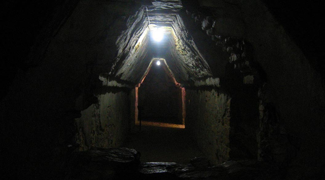 Caves were seen as entrances into the mysterious Underworld. A dark tunnel leading into a chamber at Palenque, Mexico.