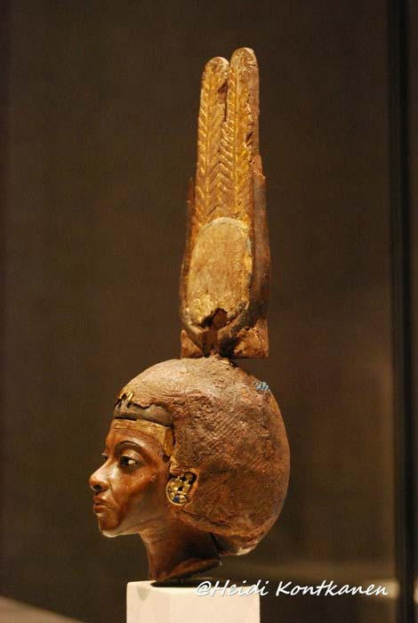 Head of a statuette of Queen Tiye, wearing a double-feathered crown, made of yew wood with silver, gold and glass. Neues Museum, Berlin