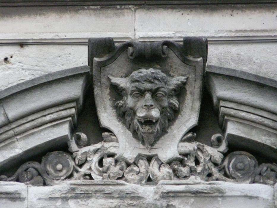 "Sculpted head of the ""Loup Garou"" or werewolf in Cognac, France."