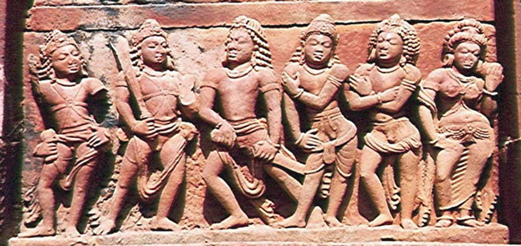 The five Pandava princes- heroes of the epic Mahabharata - with their shared wife-in-common named Draupadi.