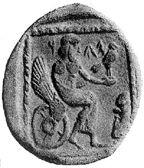 "A 4th century BCE drachm (quarter shekel) coin from the Persian province of Yehud Medinata, possibly representing Yahweh seated on a winged and wheeled throne. An inscription lies on the face of the coin, either a Phoenician inscription on the coin reading ""YHW"" or an Aramaic inscription reading ""YHD"""