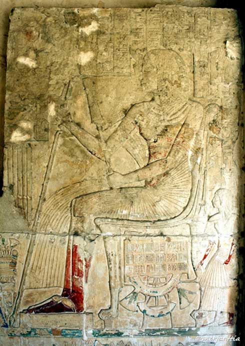 A painted limestone relief from the Memphite tomb of Horemheb shows him seated before an offering table. This elaborate sepulcher was built when he was a Generalissimo; the uraeus on his brow was added after he became pharaoh.