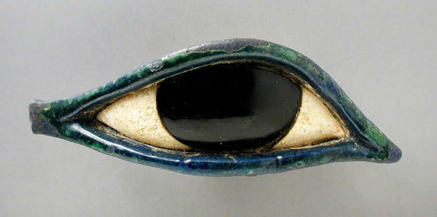 An eye made of glass and obsidian from a coffin belonging to the Late Period (724 - 333 BC). As an amulet, the popular Wedjat eye symbolized health and protection. (Los Angeles County Museum of Art)