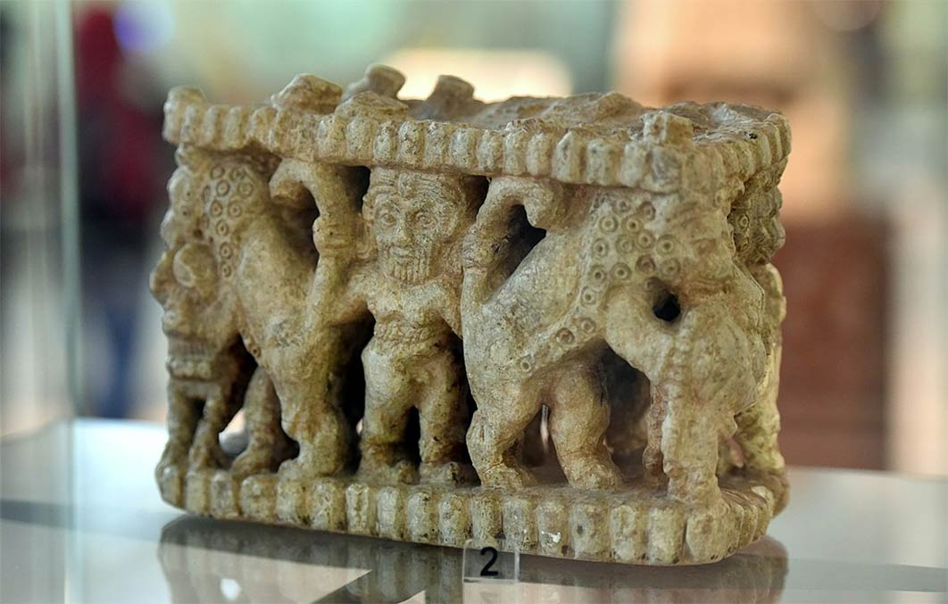 Sculpted scene depicting Gilgamesh wrestling with animals. From the Shara temple at Tell Agrab, Diyala Region, Iraq. Early Dynastic period, 2600–2370 BC. On display at the National Museum of Iraq in Baghdad. (Osama Shukir Muhammed Amin/ CC BY-SA 4.0)