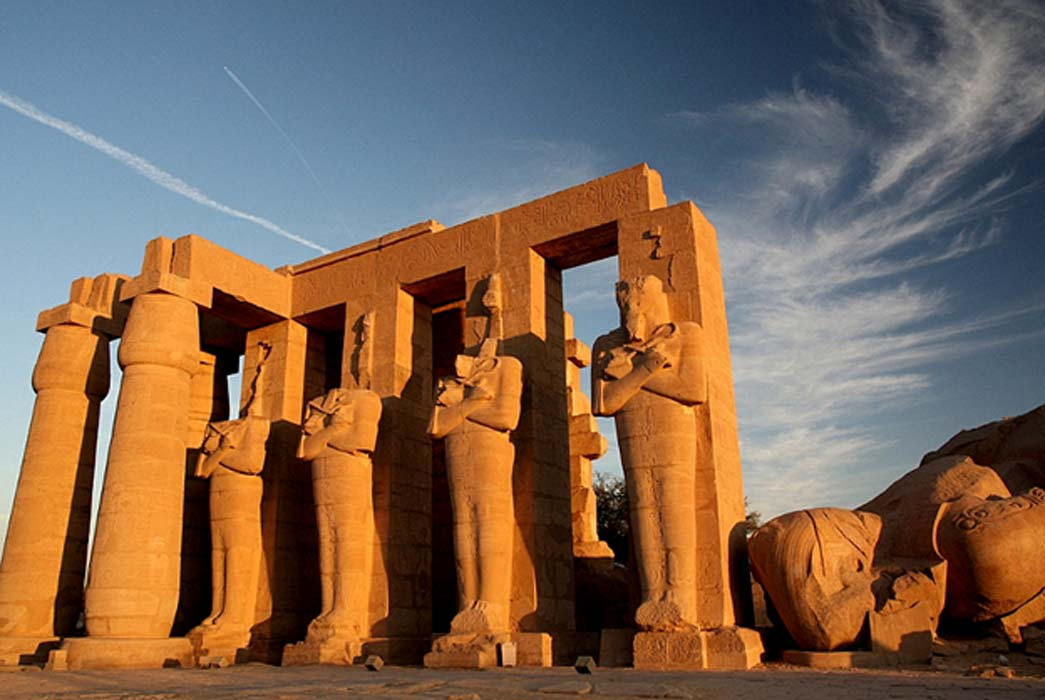 The Ramesseum witnessed high drama during the workers' protest against the third king to bear the name, Ramesses. Pictured here are headless Osiride statues of Ramesses II.