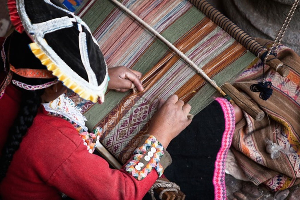 This woman is showing how local textiles are woven. Cuzco, Peru