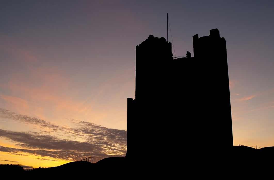 Sunset silhouette of Orford castle in Suffolk (Steve Mann / Adobe Stock)