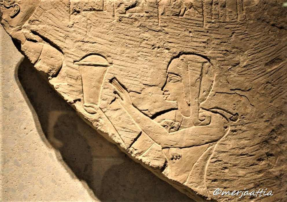 Limestone relief of Crown Prince Thutmose standing behind his father, Amenhotep III, in the role of high priest. Saqqara. Neues Museum, Berlin. (Merja Attia)