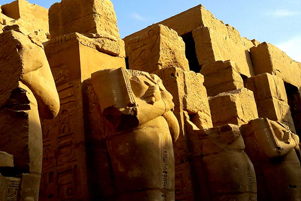 Enormous headless Osiride sculptures of Pharaoh Ramesses III stand in the colonnade of the king's Barque Chapel south of the second pylon at Karnak Temple; design by Anand Balaji