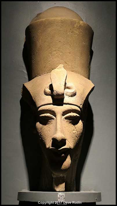 Remains of the Head of King Akhenaten from a massive statue, wearing the khat or nemes and double crown. This was among the large heads found by Henri Chevrier in 1926. Luxor Museum.