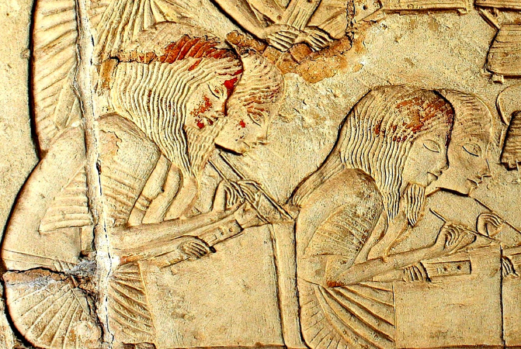On the Southern Part of the East Wall of Horemheb's Saqqaran tomb, military scribes, magnificently represented, scrupulously record the details of long files of prisoners escorted by Egyptian soldiers (not in pic). This depiction is often speculated to represent women scribes.