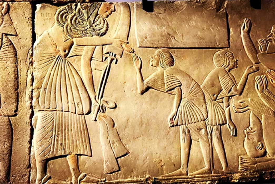 Fragmentary scene, originally from the second courtyard of his Saqqaran tomb, shows Horemheb wearing the Gold of Honor given by Tutankhamun; design by Anand Balaji