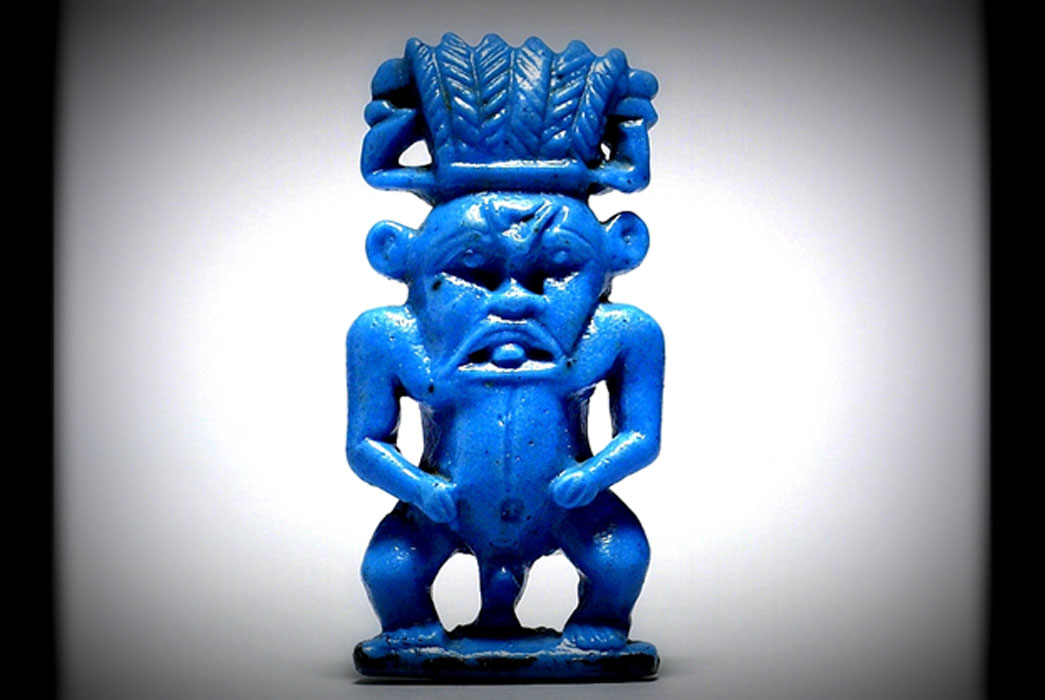 This dwarf-like, protective deity was very popular in ancient Egypt. Bes is represented with the nude body of a dwarf, grotesque facial features, and the ears and mane of a lion. He wears a tall feather-crown and usually rests his hands on his hips. Known from as early as the Middle Kingdom circa 2000 BC.