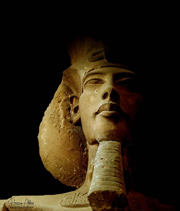This colossal sandstone sculpture of Pharaoh Akhenaten, wearing the Khat headdress and double crown, was discovered at Karnak Temple. The king's desire to rest for all eternity in the city he had built, Akhetaten, was dashed when Tutankhamun ascended the throne and shifted the capital back to Thebes. Egyptian Museum, Cairo.