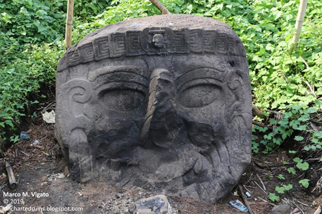 A view of the same colossal stone head still partially buried in the ground. It is the portrait of a bearded individual, of a race different from that of the present Maya population, with a long aquiline nose and slanting eyes. Could this be the portrait of an old-world visitor, perhaps a Phoenician navigator? (Image: © Marco Vigato)