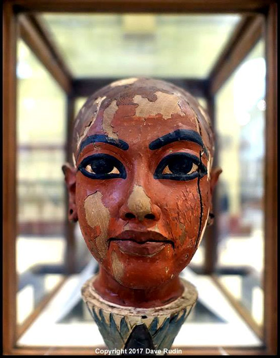 Tutankhamun presided over the demise of the Amarna dream. This painted wooden head depicts him as the god Nefertem who springs from a sacred blue water lily at dawn; symbolizing the Sun God rising. Egyptian Museum, Cairo.