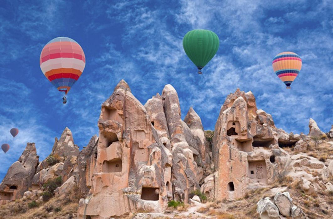 Colorful hot air balloons flying over Red valley in Cappadocia, Anatolia, Turkey (Svetlana Nikolaeva/ Adobe Stock)