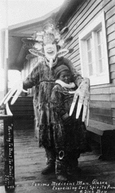 Yup'ik medicine man exorcising evil spirits from a sick boy. Nushagak, Alaska, (1890s) (Public Domain)