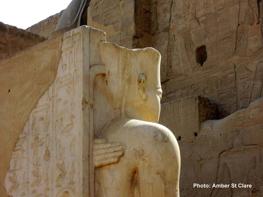 The hand of Ankhesenamun rests protectively upon the back of her husband and half-brother Pharaoh Tutankhamun in this statue at Luxor Temple. The next ruler, elderly King Aye, probably married the young queen to legitimize his claim to the throne.