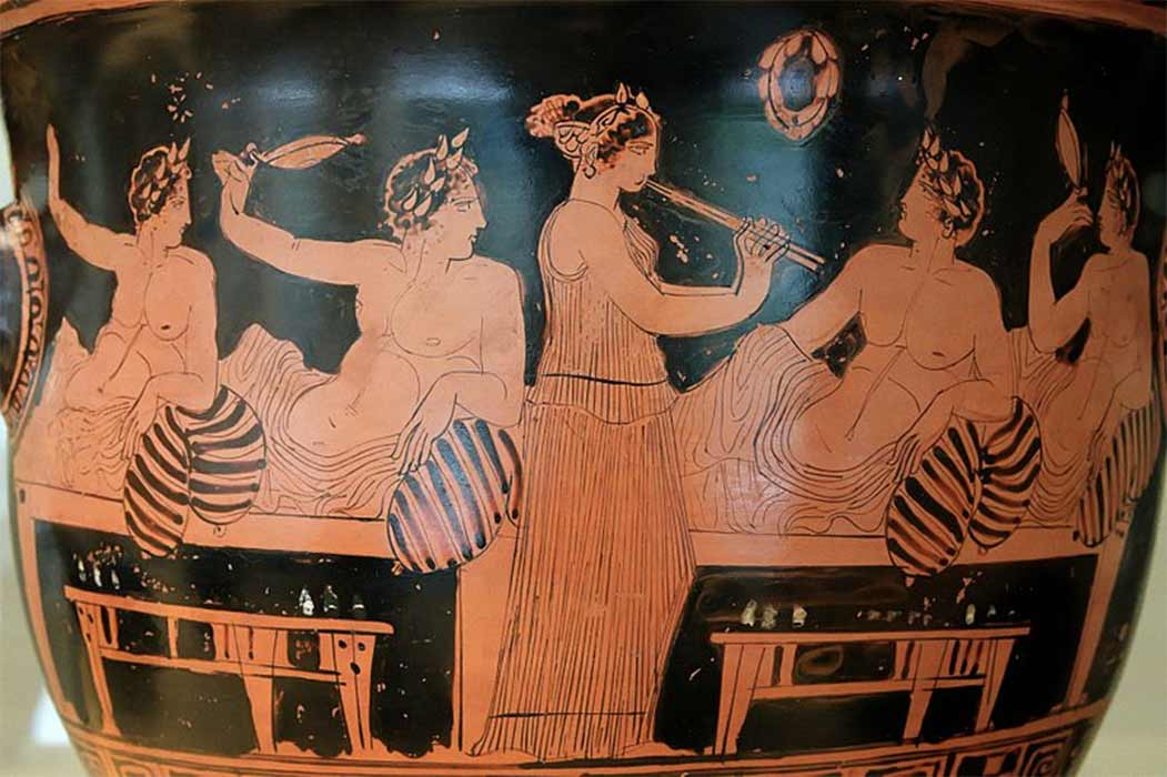Symposium scene: banqueters playing the kottabos game while a girl plays the aulos. National Archaeological Museum (CC BY-SA 2.5)