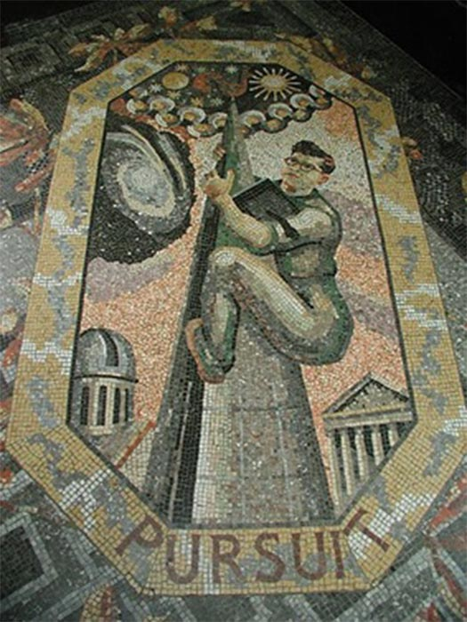 Pursuit (1952) by Boris Anrep, part of a series of mosaics of the Modern Virtues in the entrance hall of the National Gallery, London. It depicts the astronomer Sir Fred Hoyle as a steeplejack climbing up to the stars. (CC BY-SA 2.0)