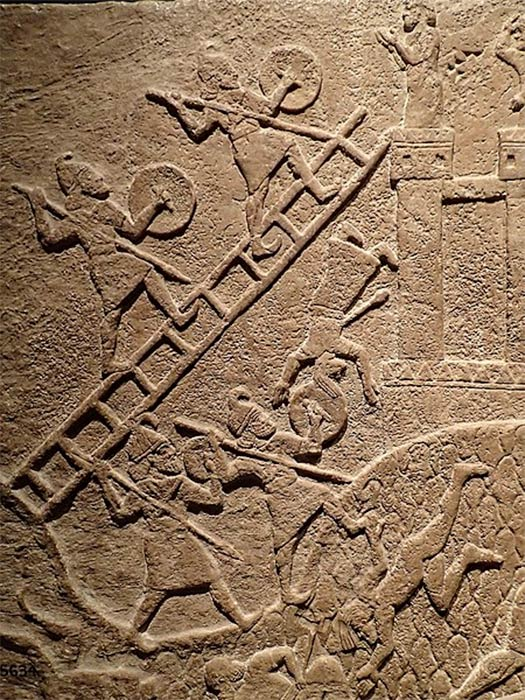 Assyrians using 'siege ladders' attacking an enemy town during the reign of Tiglath-Pileser III 720-738 BC, carved in his royal palace at Kalhu (Nimrud). (Mary Harrsch/ CC BY-SA 4.0)