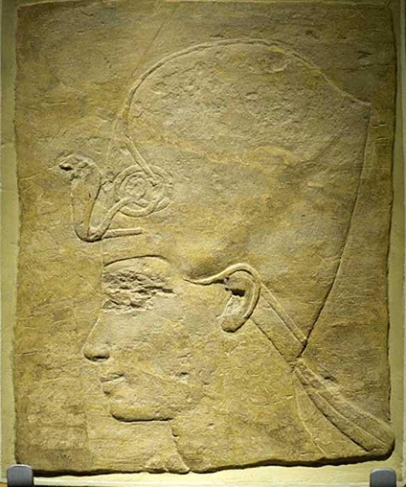 A sandstone portrait of King Tutankhamun wearing the khepresh or Blue (War) Crown. Rijksmuseum van Oudheden, Leiden.