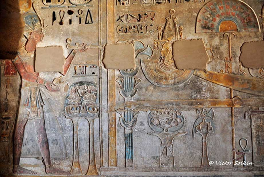 A scene on a wall in the mortuary temple of Ramesses III shows the king making an offering of incense and libation in front of a sacred bark of the deified Ramesses II. Medinet Habu.