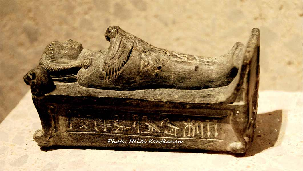 """This schist statuette of Crown Prince Thutmose, brother of Akhenaten, depicts him on a bier with a Ba bird on his chest. He is shown as a high priest of Ptah at Memphis and wears a wig and sports a sidelock. The inscription reads: """"The King's Son, Sem Priest, Djhutmose"""". Neues Museum, Berlin. (Heidi Kontkanen)"""