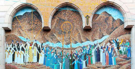 Mosaic representing Jesus Christ at the entrance of a small Coptic church with a wooden column porch in the Christian quarter of Cairo ( peizais/ Adobe Stock)