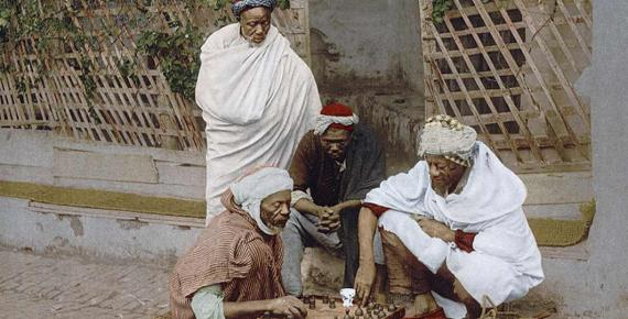 Men Playing Board Games in Alegria (1890 – 1900) (Public Domain)