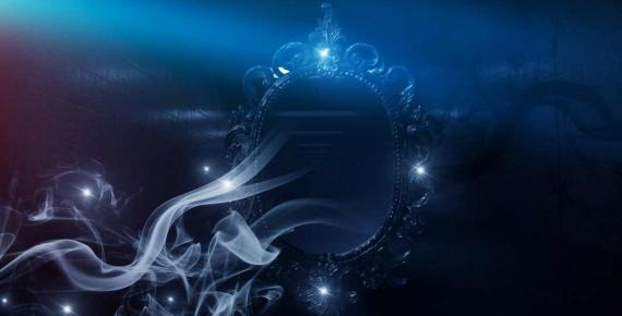 Mirror magic, fortune telling and fulfillment of desires. Fantasy with a mirror, dark room, magical power, night view. (MiaStendal /Adobe Stock)