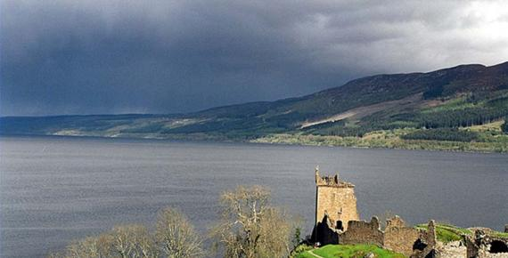 Looking south across Loch Ness from Urquhart Castle, Boleskine House is the white cottage on the hillside. Many locals claim sightings of the Loch Ness Monster increased after Crowley resided here.