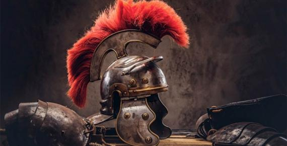 Complete combat equipment of the ancient Roman warrior lie on a box of wooden boards. (Fxquadro / Adobe Stock)