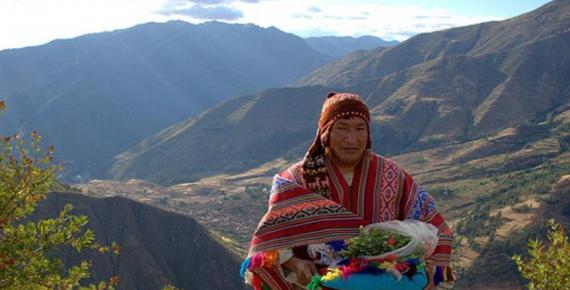 A traditional Andean spiritual leader arrives at the location for the offering ceremony with the items needed for the mesa.